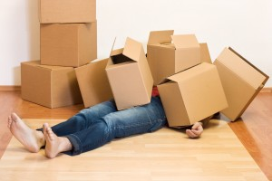 womanundermoving boxes